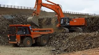 Hitachi Zaxis 870 LCH excavator loading blasted rock (part 1)