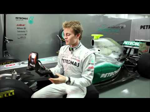 F1 2011 - Rosberg explains the HANS (Head And Neck Support system)