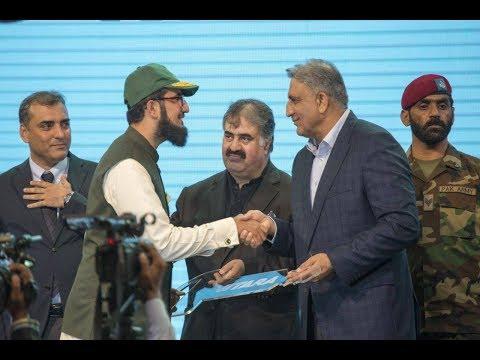 Army Chief Gen Qamar Javed Bajwa presenting winning trophy to Champion of Gwadar Sahibzada Sultan