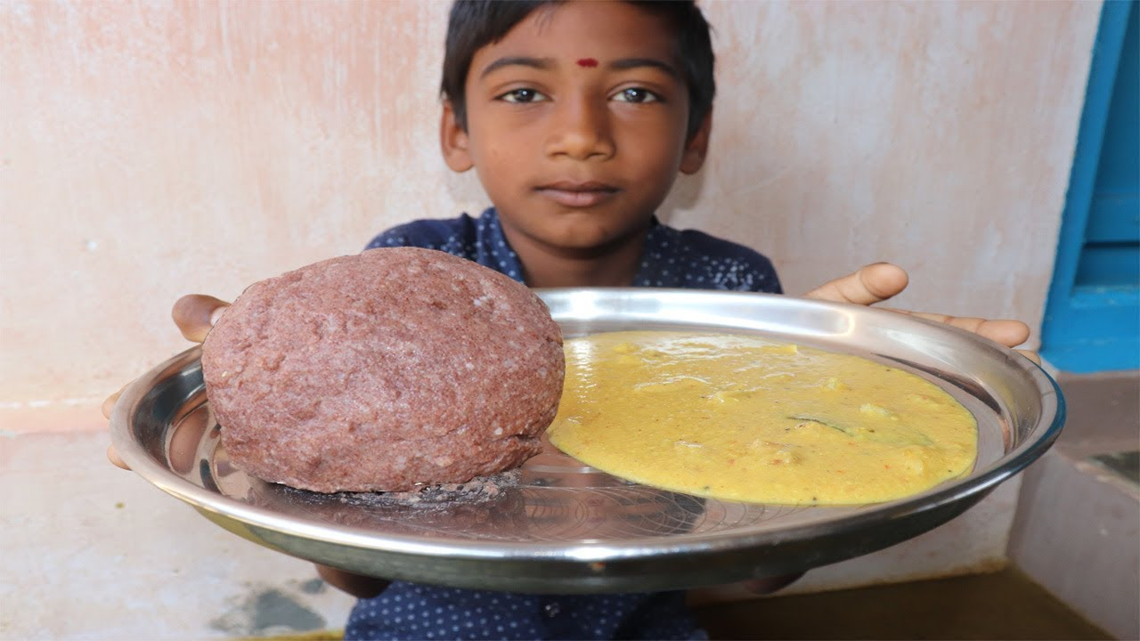 Small Boy Eating Full Ragi Kali with Dal Kulambhu/Gravy / Food Eat Taste