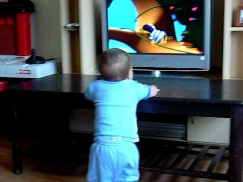 Chase watching Zigby while standing up