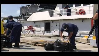 Coast Guard Cutter Paul Clark crew members offload contraband
