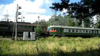 Diesel locomotive is a pulling an electric train near Vaskelovo station