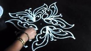 kolam with 9 dots - butterfly rangoli design