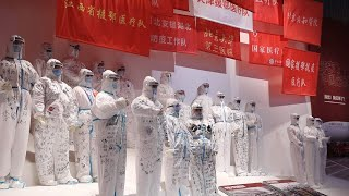Wuhan opens exhibition on fighting against COVID-19