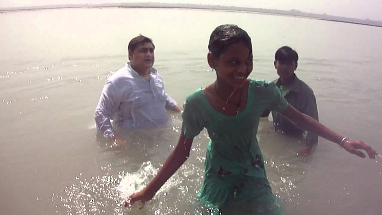 Image result for Photo published for Baptism service in the river ganges.Haridwar. photo picture image