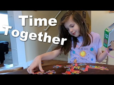 Autistic Girl Puts Together a Puzzle with Mom