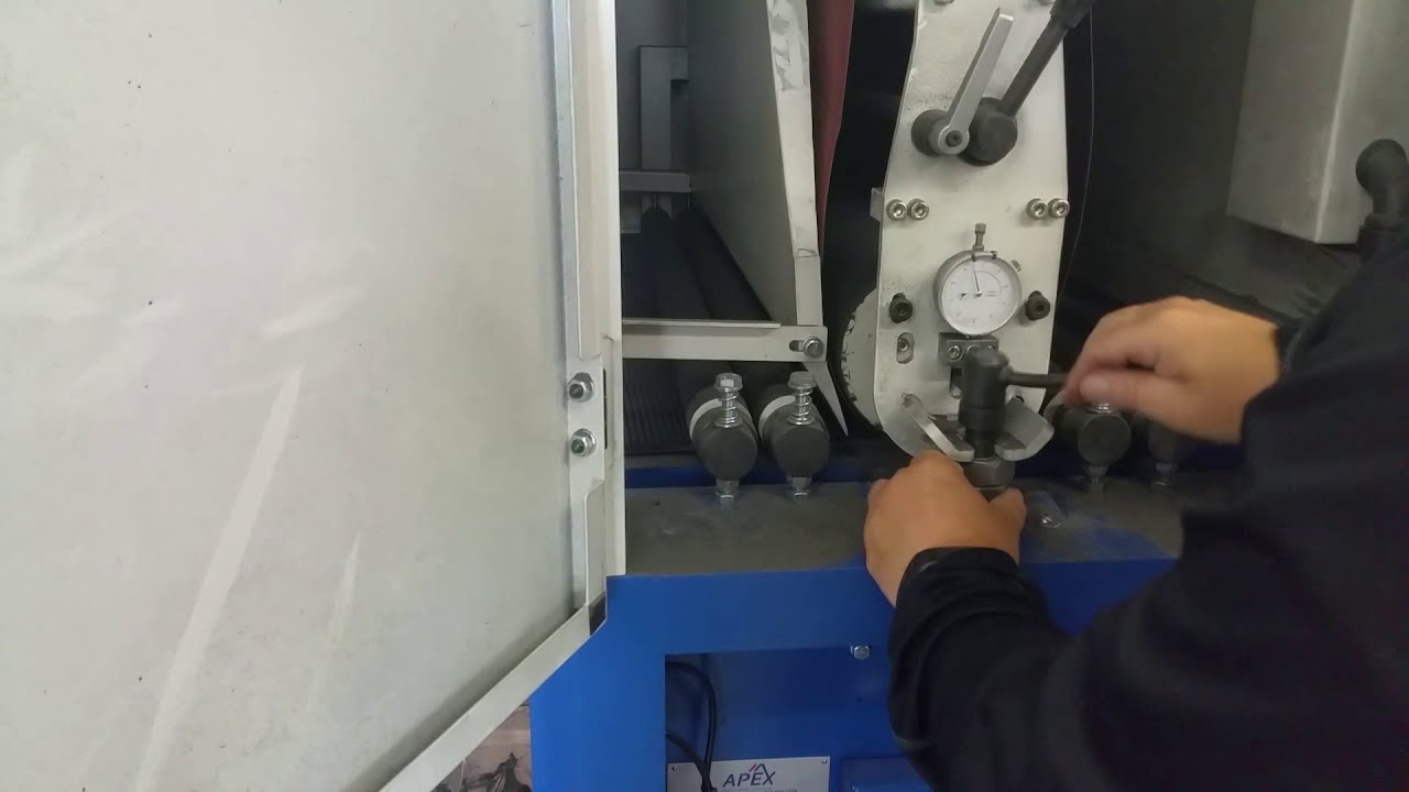 Finish sanding of plasma cut steel signs on EZ Sander