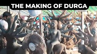 Artists from Bengal engaged in creating Durga clay idols near Beach Road in Visakhapatnam