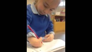 Arielle 7 year old girl doing homework-arthrogryposis