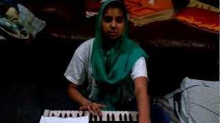 Jessica playing harmonium
