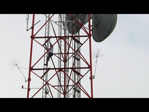 Florida News - Man Climbs TV Tower in Orlando
