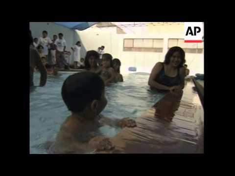 PERU: MONTERRICO ACADEMY TEACHES BABIES HOW TO SWIM