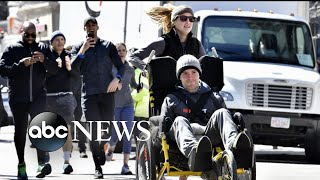 Woman completes Boston Marathon early, pushing boyfriend in wheelchair