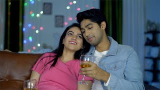 Beautiful Indian couple enjoying happy conversation at home on Valentine's day