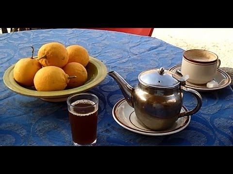 Drinking tea in the cafe by the Roman Amphitheatre in El Djem (El Jem) in Tunisia.