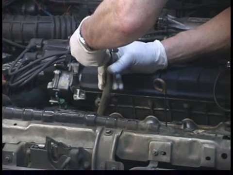 How to Replace a Car Radiator : Disconnecting Transmission Lines  to Replace Car Radiator