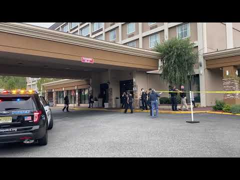 Police were searching for the assailant who shot a man Thursday afternoon at the Holiday Inn on Route 4 in Fort Lee.