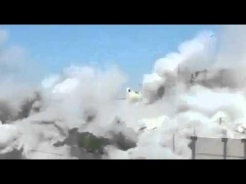 Israeli missile destroying a civilian building in Gaza