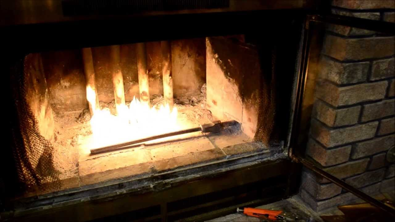 A step by step tutorial showing how to remove and clean a blocked gas diffuser in a gas-assisted start wood burning fireplace.