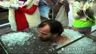 Wim Hof, a holder of nine Guinness World Records, submerges himself...