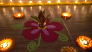 Bokeh shot of a decorated rangoli in dark with festive background - Diwali festival
