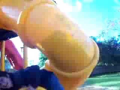Fat kid getting stuck in a slide