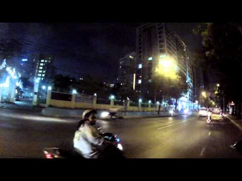 Scooter ride in Vietnam, Saigon (Ho chi minh city) in the evening