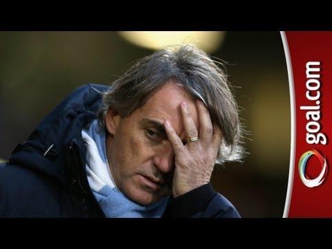 Mancini criticises referee after narrow win at Norwich