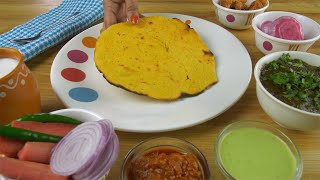 Closeup shot of woman hands serving Makki ki Roti in a designer plate - food concept