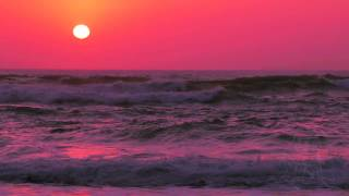 Sunset over Ocean Surf. Slow Motion