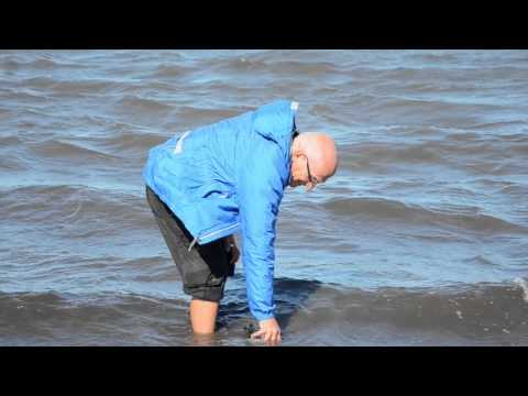 Filling water bottle in Arctic Ocean 2015