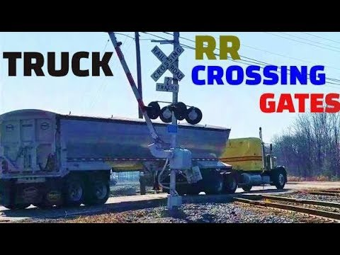 Truck Runs Past Railroad Crossing Gates