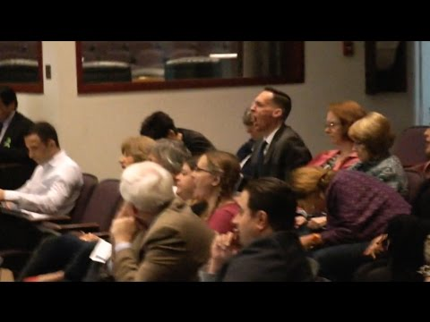 """Audience members shout """"shame"""" at OC supervisors for expanding immigration detention"""