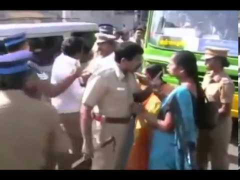 Tamil Police Beating a lady in public...