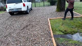 Muddy driveway cheap rock cheap border helps