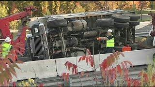 Dump Truck with asphalt overturns on I-91