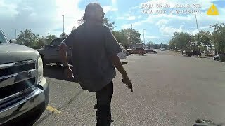 Lapel video of suspect shooting at police officers during chase