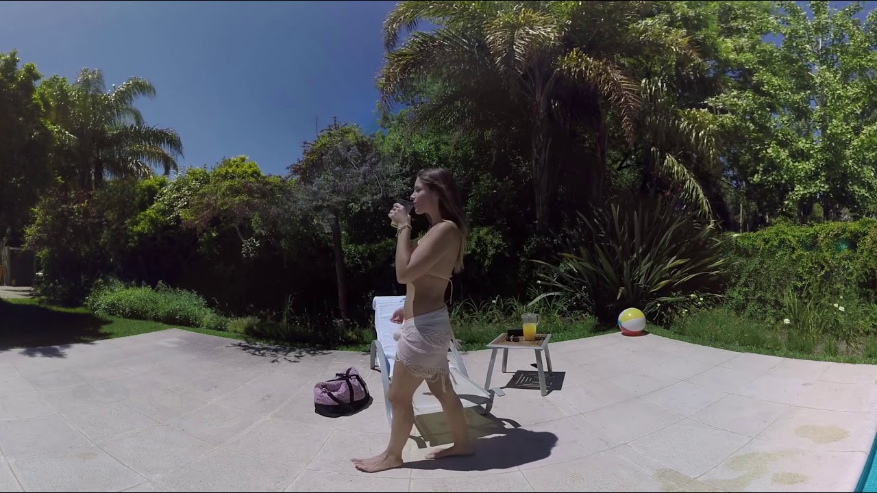 Sunbathing and dancing by the pool