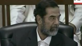 شاهد اشارة صدام لرفاقه بقتل المدعي العام منقذ فرعون وكيف انتقم منه