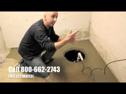 Arid Basement Waterproofing installing a French drain