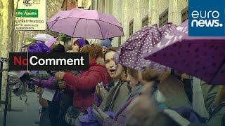 Thousands of women dye Madrid purple with human chain against violence
