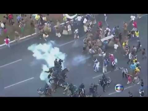 Brazilian protesters in traditional dress clash with police