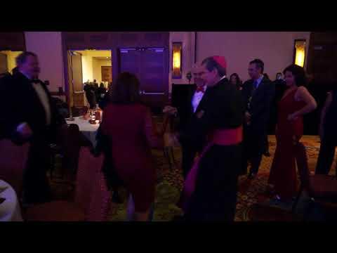 Archbishop Gustavo group dance at the St. Nicholas Ball