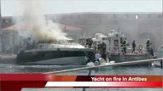 Yacht on fire in Antibes port Vauban