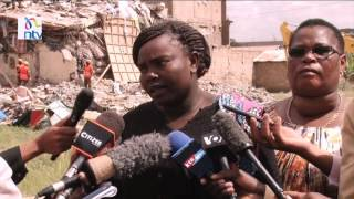 Three found alive in collapsed building
