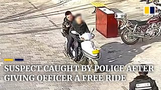 Suspect in China caught by police after giving officer a ride