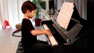 "Daniel (age 5) practicing piano, playing ""Little Playmates"" - Nov 13, 2011."