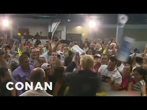 Puerto Ricans Respond To Trump's Paper Towel Toss  - CONAN on TBS