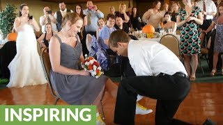 Surprise proposal takes place during wedding reception
